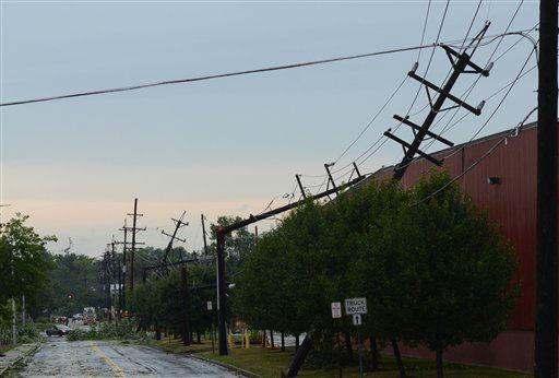 A row of broken power lines reveal the path that a tornado took after it struck Elmira N.Y., Thursday, July 26, 2012. Power lines and trees were toppled and hospitals were placed on disaster alert but there were no immediate reports of injuries after a possible tornado hit the city of Elmira Thursday afternoon, Chemung County Office of Fire and Emergency Management spokeswoman Karen Miner said. &#40;AP Photo&#47;Heather Ainsworth&#41; <span class=meta>(AP Photo&#47; Heather Ainsworth)</span>