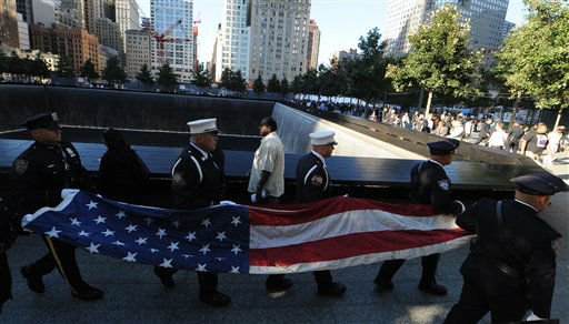 Firefighters carry a flag as friends and relatives of the victims of the Sept. 11 terrorist attacks on the World Trade Center attend a ceremony marking the 11th anniversary of the attacks at the National September 11 Memorial at the World Trade Center site in New York, Tuesday, Sept. 11, 2012. &#40;AP Photo&#47;The Daily News, Todd Maisel, Pool&#41; <span class=meta>(AP Photo&#47; Todd Maisel)</span>