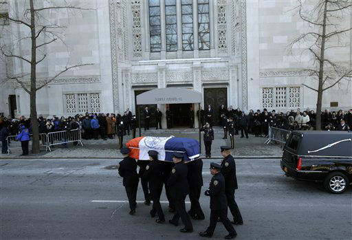 The casket containing the body of former New York City Mayor Ed Koch is brought into a synagogue for his funeral in New York, Monday, Feb. 4, 2013. Koch died Friday of congestive heart failure at age 88.  &#40;AP Photo&#47;Seth Wenig&#41; <span class=meta>(AP Photo&#47; Seth Wenig)</span>