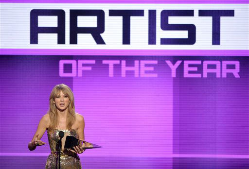 Taylor Swift accepts the award for artist of the year at the American Music Awards at the Nokia Theatre L.A. Live on Sunday, Nov. 24, 2013, in Los Angeles. (Photo by John Shearer/Invision/AP)
