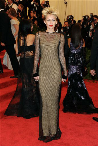 "Singer Miley Cyrus attends The Metropolitan Museum of Art Costume Institute gala benefit, ""Punk: Chaos to Couture"", on Monday, May 6, 2013 in New York. (Photo by Evan Agostini/Invision/AP)"