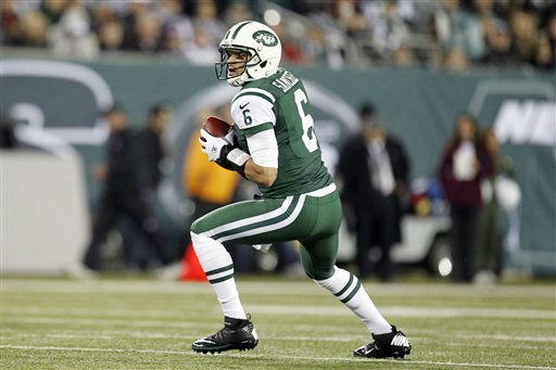 "<div class=""meta ""><span class=""caption-text "">New York Jets quarterback Mark Sanchez (6) looks to pass during the first half of an NFL football game against the New England Patriots Thursday, Nov. 22, 2012 in East Rutherford, N.J. (AP Photo/Julio Cortez) (AP Photo/ Julio Cortez)</span></div>"