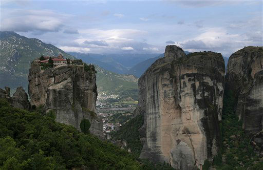 The monastery of Agia Trias is seen at Meteora in northern central Greece, on Tuesday May 14, 2013. Meteora, a UNESCO World Heritage site, is best known for its clifftop monasteries, some more than 500-years old. Greece is hoping for a busy tourist season with foreign visitors in 2013,  but hotel associations at destinations like Meteora, which are favored by the domestic market, have reported weak bookings from Greek people so far this year as the country continues to suffer through financial crisis. &#40;AP Photo&#47;Dimitri Messinis&#41; <span class=meta>(AP Photo&#47; Dimitri Messinis)</span>