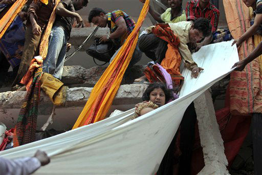 Rescue workers use pieces of clothes to bring down a survivor after an eight-story building housing several garment factories collapsed in Savar, near Dhaka, Bangladesh, Wednesday, April 24, 2013. The building collapsed near Bangladesh&#39;s capital Wednesday morning, killing dozens of people and trapping many more in the rubble, officials said. &#40;AP Photo&#47; A.M. Ahad&#41; <span class=meta>(AP Photo&#47; A.M. Ahad)</span>