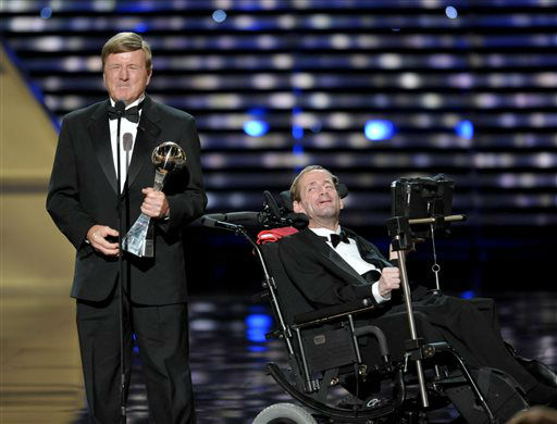 Dick Hoyt, left, and Rick Hoyt,  accept the Jimmy V Perseverance Award at the ESPY Awards on Wednesday, July 17, 2013, at the Nokia Theater in Los Angeles. &#40;Photo by John Shearer&#47;Invision&#47;AP&#41; <span class=meta>(Photo&#47;John Shearer)</span>