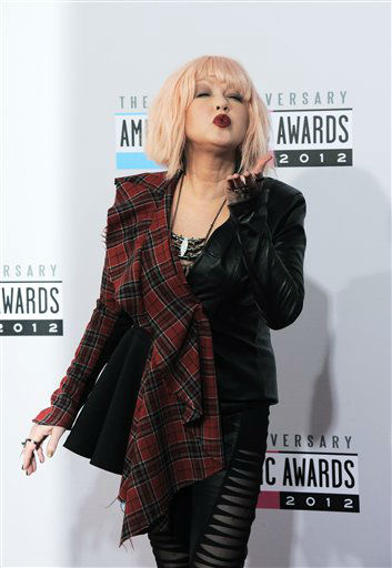 "<div class=""meta ""><span class=""caption-text "">Cyndi Lauper arrives at the 40th Anniversary American Music Awards on Sunday, Nov. 18, 2012, in Los Angeles. (Photo by Jordan Strauss/Invision/AP) (AP Photo)</span></div>"