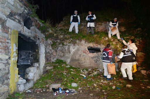 Police officers search for missing New York City woman Sarai Sierra near the remnants of some ancient city walls in low-income district of Sarayburnu in Istanbul, Turkey, late Saturday, Feb. 2, 2013. Turkey&#39;s state-run news agency said that she has been found dead in Istanbul and police have detained nine people in connection with the case. Sierra, a 33-year-old mother of two, went missing while vacationing alone in Istanbul. Her body was discovered late Saturday near the remnants. &#40;AP Photo&#41; <span class=meta>(AP Photo&#47; Uncredited)</span>