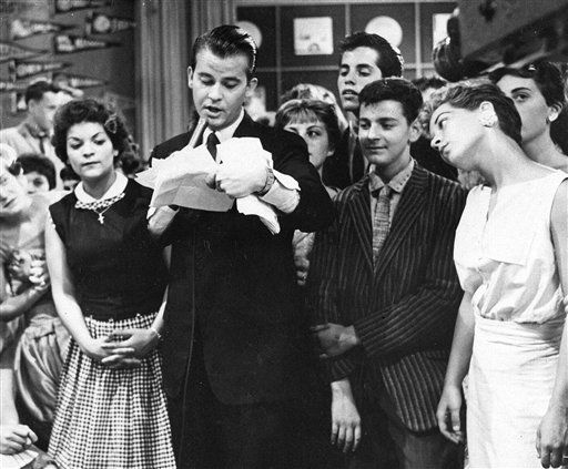 "<div class=""meta ""><span class=""caption-text "">FILE - In this 1957 file photo, Dick Clark is seen surrounded by fans during a television broadcast of ""American Bandstand."" Clark, the television host who helped bring rock `n' roll into the mainstream, died Wednesday, April 18, 2012 of a heart attack. He was 82. (AP Photo/File) (AP Photo/ Anonymous)</span></div>"