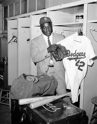 Jackie Robinson, 38, empties his locker at the clubhouse of the Brooklyn Dodgers baseball club in Ebbets Field, closing out a ten-year starring stint with the club, in New York, Jan. 7, 1957. Robinson was quitting baseball to sit behind a desk as vice president in charge of personnel for Chock Full O&#39; Nuts company.  &#40;AP Photo&#47;Jacob Harris&#41; <span class=meta>(AP Photo&#47; Jack Harris)</span>