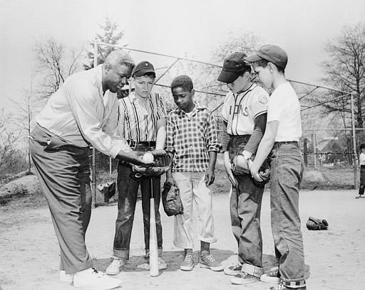"<div class=""meta image-caption""><div class=""origin-logo origin-image ""><span></span></div><span class=""caption-text"">Former Brooklyn Dodger Jackie Robinson gives instructions to his son Jackie Jr., and his teammates of his little league team in Stamford, Conn., on April 27, 1957.  (AP Photo) (AP Photo/ Anonymous)</span></div>"