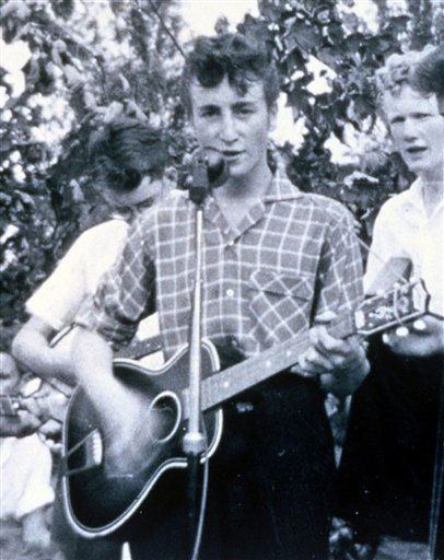 John Lennon performs on stage with his first band the &#39;Quarry Men&#39; at a church function in Woolton, Merseyside, Great Britain, July 6, 1957. &#40;AP Photo&#47;Str&#41; --- John Lennon spiel Guitarre bei einem Auftritt mit seiner ersten Band, den Quarry Men, auf einem Kirchenfest in Woolton, Merseyside; Grossbitannien am 6. Juli 1957. &#40;AP Photo&#47;Str&#41; <span class=meta>(AP Photo&#47; STR)</span>