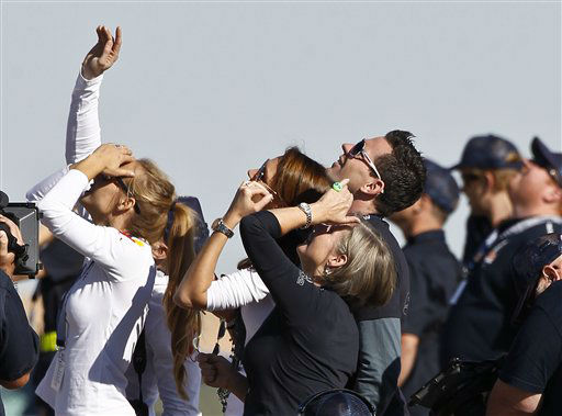 "<div class=""meta ""><span class=""caption-text "">Felix Baumgartner's mother Ava Baumgartner, middle, watches with other family members and friends as his capsule lifts off as he attempts to break the speed of sound with his own body by jumping from a space capsule lifted by a helium balloon, Sunday, Oct. 14, 2012, in Roswell, N.M.  Baumgartner plans to jump from an altitude of 120,000 feet, an altitude chosen to enable him to achieve Mach 1 in free fall, which would deliver scientific data to the aerospace community about human survival from high altitudes.(AP Photo/Ross D. Franklin) (AP Photo/ Ross Franklin)</span></div>"