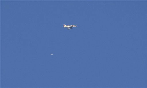 "<div class=""meta image-caption""><div class=""origin-logo origin-image ""><span></span></div><span class=""caption-text"">An Israel war plane drops a bomb over the northern Gaza Strip, seen from the Israel Gaza Border, southern Israel, Thursday, Nov. 15, 2012. (AP Photo/Ariel Schalit) (AP Photo/ Ariel Schalit)</span></div>"