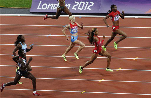 From right, United States&#39; Deedee Trotter, United States&#39; Sanya Richards-Ross, Russia&#39;s Antonina Krivoshapka, Britain&#39;s Christine Ohuruogu, and Botswana&#39;s Amantle Montsho compete in the women&#39;s 400-meter final during the athletics in the Olympic Stadium at the 2012 Summer Olympics, London, Sunday, Aug. 5, 2012. &#40;AP Photo&#47;Christophe Ena&#41; <span class=meta>(AP Photo&#47; Christophe Ena)</span>