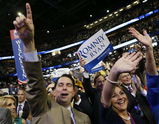 "<div class=""meta ""><span class=""caption-text "">Wisconsin Gov. Scott Walker and his wife Tonette cheer as Republican vice presidential nominee, Rep. Paul Ryan addresses the Republican National Convention in Tampa, Fla., on Wednesday, Aug. 29, 2012. (AP Photo/David Goldman) (AP Photo/ David Goldman)</span></div>"