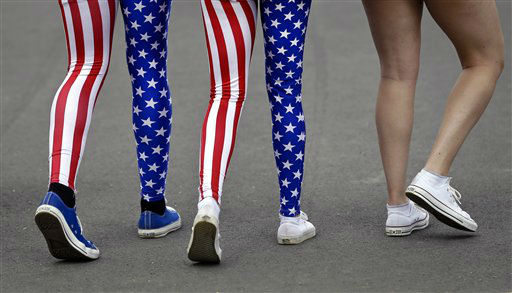 "<div class=""meta ""><span class=""caption-text "">Nick Miller, left, and his sister Kendall Miller, center, from San Francisco, wear leotards in the colors of the United States national flag as they walk with a friend through Olympic Park at the 2012 Summer Olympics, Thursday, Aug. 2, 2012, in London. (AP Photo/Ben Curtis) (AP Photo/ Ben Curtis)</span></div>"