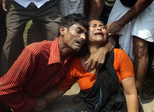 "<div class=""meta ""><span class=""caption-text "">Relatives mourn a victim at the site where an eight-story building housing several garment factories collapsed in Savar, near Dhaka, Bangladesh, Wednesday, April 24, 2013.  The building collapsed near Bangladesh's capital Wednesday morning, killing dozens of people and trapping many more in the rubble, officials said. (AP Photo/ A.M. Ahad) (AP Photo/ A.M. Ahad)</span></div>"