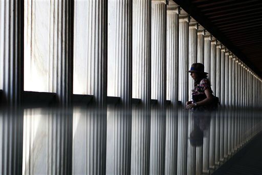 "<div class=""meta image-caption""><div class=""origin-logo origin-image ""><span></span></div><span class=""caption-text"">A tourist is reflected in a glass surface as she walks in the newly opened first floor of the Museum of the ancient Agora, Stoa of Attalos, central Athens, on Thursday, May 30, 2013. Greece?s conservative-led government is hoping for a strong performance in the country?s vital tourism sector this year to help deliver on its promise to end a crippling recession in 2014. (AP Photo/Petros Giannakouris) (AP Photo/ Petros Giannakouris)</span></div>"