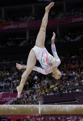 Chinese gymnast Deng Linlin performs on the balance beam during the artistic gymnastics women&#39;s apparatus finals at the 2012 Summer Olympics, Tuesday, Aug. 7, 2012, in London. &#40;AP Photo&#47;Julie Jacobson&#41; <span class=meta>(AP Photo&#47; Julie Jacobson)</span>