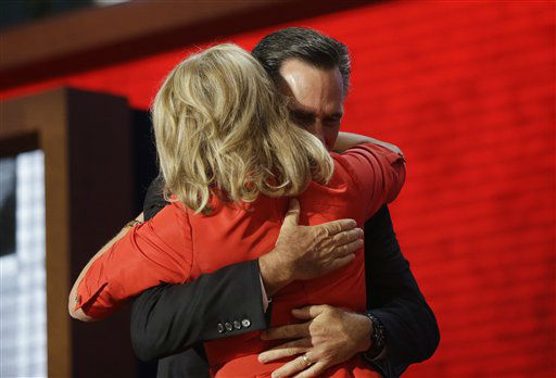 Republican presidential nominee Mitt Romney hugs his wife Ann Romney on stage at the Republican National Convention in Tampa, Fla. on Tuesday, Aug. 28, 2012. &#40;AP Photo&#47;Charles Dharapak&#41; <span class=meta>(AP Photo&#47; Charles Dharapak)</span>