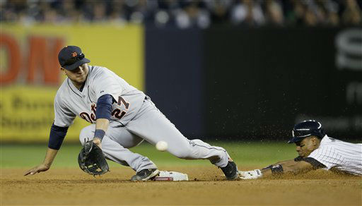 New York Yankees&#39; Curtis Granderson steals second as Detroit Tigers&#39; Jhonny Peralta waits for the throw in the seventh inning of Game 2 of the American League championship series Sunday, Oct. 14, 2012, in New York. &#40;AP Photo&#47;Matt Slocum&#41; <span class=meta>(AP Photo&#47; Matt Slocum)</span>