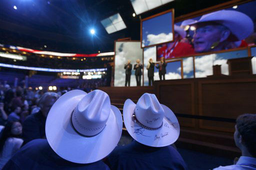 "<div class=""meta ""><span class=""caption-text "">Texas delegates David Watrous from Dallas and Alice Rekeweg from Houston  watch as the Oak Ridge Boys perform during  the Republican National Convention in Tampa, Fla., on Tuesday, Aug. 28, 2012. (AP Photo/David Goldman) (AP Photo/ David Goldman)</span></div>"