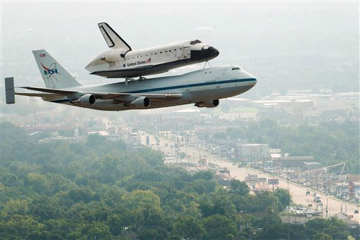 "<div class=""meta ""><span class=""caption-text "">The space shuttle Endeavour, carried atop NASA's 747 Shuttle Carrier Aircraft, passes over neighborhoods near Hobby Airport during a flyover on Wednesday, Sept. 19, 2012, in Houston. Endeavour stopped in Houston on its way from the Kennedy Space Center to the California Science Center in Los Angeles, where it will be placed on permanent display. (AP Photo/Houston Chronicle, Smiley N. Pool, Pool) (AP Photo/ Smiley N. Pool)</span></div>"
