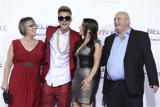 Singer Justin Bieber, second from left, poses with Grandmother Diane Dale, left, his Mother Pattie Mallette, second from right, and his Grandfather Bruce Dale at the premiere of the feature film &#34;Justin Bieber&#39;s Believe&#34; at Regal Cinemas L.A. Live on Wednesday, Dec. 18, 2013 in Los Angeles. &#40;Photo by Dan Steinberg&#47;Invision&#47;AP&#41; <span class=meta>(Photo&#47;Dan Steinberg)</span>