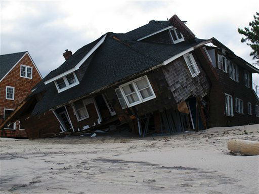 An oceanfront home is destroyed in Mantoloking, N.J., on Oct. 31, 2012. Sandy, the storm that made landfall Monday, caused multiple fatalities, halted mass transit and cut power to more than 6 million homes and businesses. &#40;AP Photo&#47;Wayne Parry&#41; <span class=meta>(AP Photo&#47; Wayne Parry)</span>