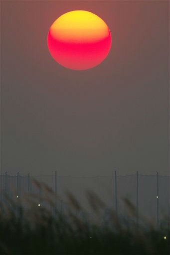 In this Tuesday, Feb. 12, 2013 photo, the sun goes down over the Mekong river in the outskirt of Phnom Penh, Cambodia. &#40;AP Photo&#47;Heng Sinith&#41; <span class=meta>(AP Photo&#47; Heng Sinith)</span>
