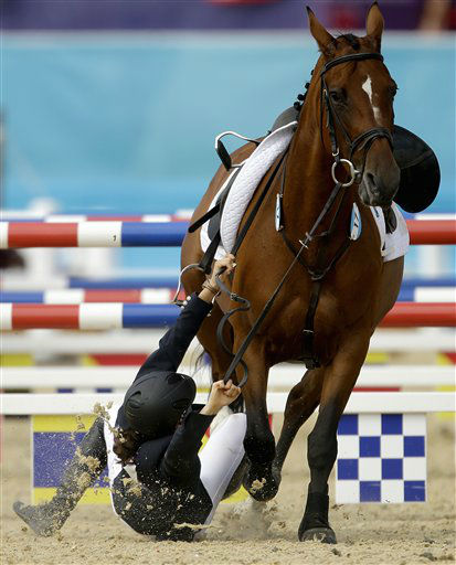 Tamara Vega, of Mexico, falls off her horse Douce de Roulad, during the equestrian show jumping stage of the women&#39;s modern pentathlon at the 2012 Summer Olympics, Sunday, Aug. 12, 2012, in London. &#40;AP Photo&#47;David Goldman&#41; <span class=meta>(AP Photo&#47; David Goldman)</span>