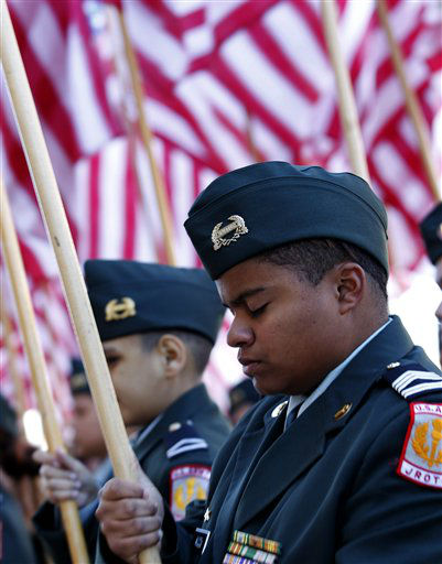 A ROTC member bows his head during a prayer in front of Dallas City Hall before the Veterans Day parade Monday, Nov. 12, 2012, in Dallas.  &#40;AP Photo&#47;LM Otero&#41; <span class=meta>(AP Photo&#47; LM Otero)</span>