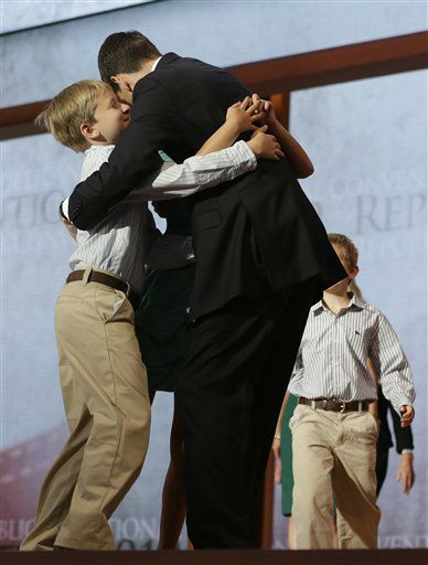 Republican vice presidential nominee, Rep. Paul Ryan hugs his children, from left, Sam and Liza, as Charlie, right, and wife Janna walk up to him after his acceptance speech during the Republican National Convention in Tampa, Fla., on Wednesday, Aug. 29, 2012. &#40;AP Photo&#47;Charles Dharapak&#41; <span class=meta>(AP Photo&#47; Charles Dharapak)</span>