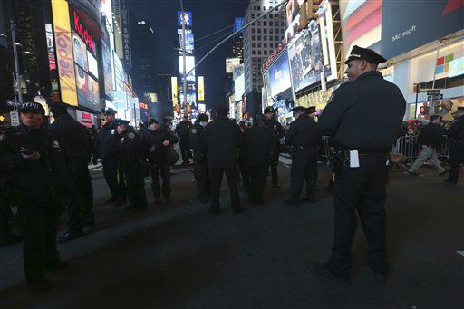 New York City police officers stand guard during the Times Square New Year&#39;s Eve celebration, Monday, Dec. 31, 2012 in New York.  &#40;AP Photo&#47;Mary Altaffer&#41; <span class=meta>(AP Photo&#47; Mary Altaffer)</span>