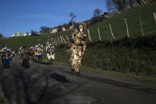 A man dressed as a  &#39;Trapajon,&#39; representing entities of nature, jumps while participating in the Vijanera Festival in Silio, northern Spain, Sunday, Jan. 6, 2013. The Vijanera masquerade, of pre-Roman origin, is the first carnival of the year in Europe symbolizing the triumph of good over evil and involving the participation of crowds of residents wearing different masks, animal skins and brightly colored clothing with its own complex function and symbolism and becoming the living example of the survival of archaic cults to nature. &#40;AP Photo&#47;Daniel Ochoa de Olza&#41; <span class=meta>(AP Photo&#47; Daniel Ochoa De Olza)</span>