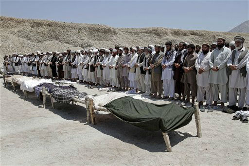 Afghan men offer funeral prayers near the bodies of 7 civilians killed, by a roadside bomb in the Alingar district of Laghman province, east of Kabul, Afghanistan, Monday, June 03, 2013. A statement from the provincial government said a group of four women and two children had gone with a male driver into the hills to collect firewood. On their way back, their vehicle hit the mine and all inside were killed. &#40;AP Photo&#47;Rahmat Gul&#41; <span class=meta>(AP Photo&#47; Rahmat Gul)</span>