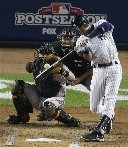 New York Yankees&#39; Derek Jeter hits an RBI triple during the third inning of Game 3 of the Yankees&#39; American League division baseball series against the Baltimore Orioles on Wednesday, Oct. 10, 2012, in New York. The Orioles catcher is Matt Wieters and the umpire is Brian Gorman. &#40;AP Photo&#47;Peter Morgan&#41; <span class=meta>(AP Photo&#47; Peter Morgan)</span>