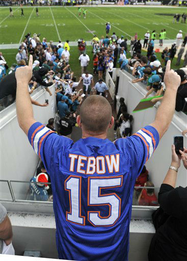Tim Tebow fan Bob Brown, wearing a University of Florida jersey, cheers as New York Jets quarterback Tim Tebow leaves the field after warming up prior to an NFL football game against the Jacksonville Jaguars, Sunday, Dec. 9, 2012, in Jacksonville, Fla. &#40;AP Photo&#47;Stephen Morton&#41; <span class=meta>(AP Photo&#47; Stephen Morton)</span>