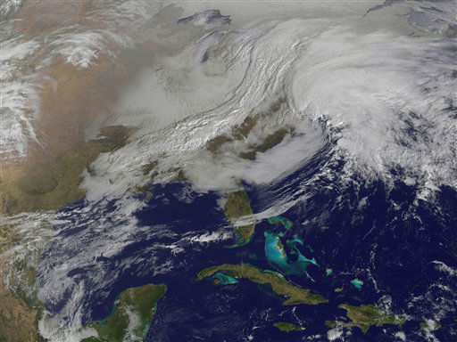 "<div class=""meta ""><span class=""caption-text "">This image released by NASA from NOAA's GOES-13 satellite captured at 9:01 a.m. on Friday, Feb. 8, 2013 shows a massive winter storm coming together as two low pressure systems merge over the northeast U.S. Snow began falling across the Northeast on Friday, ushering in what was predicted to be a huge, possibly historic blizzard and sending residents scurrying to stock up on food and gas up their cars. (AP Photo/NASA) (AP Photo/ Uncredited)</span></div>"