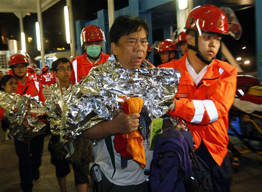 Survivors accompanied by rescuers, are taken onto shore after a collision involving two vessels in Hong Kong Tuesday, Oct. 2, 2012. Authorities in Hong Kong have rescued 101 people after a ferry collided with a boat and sank. A local broadcaster says eight people died.The government said in a statement that the ferry was carrying about 120 people when the accident happened Monday night near Lamma Island, off the southwestern coast of Hong Kong Island. Few other details were given. &#40;AP Photo&#47;Vincent Yu&#41; <span class=meta>(AP Photo&#47; Vincent Yu)</span>