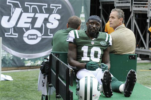 New York Jets wide receiver Santonio Holmes &#40;10&#41; is carted off the field after being injured on a play during the second half of an NFL football game against the San Francisco 49ers Sunday, Sept. 30, 2012, in East Rutherford, N.J. &#40;AP Photo&#47;Bill Kostroun&#41; <span class=meta>(AP Photo&#47; Bill Kostroun)</span>