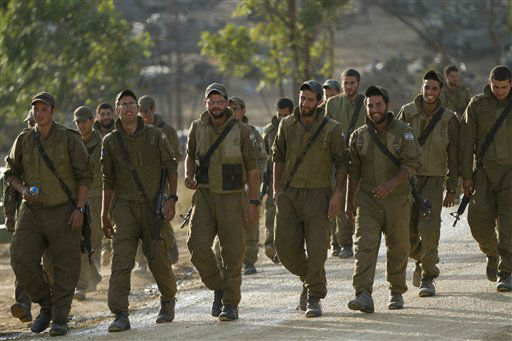 Israeli soldiers march in a gathering area near the Israel Gaza Strip border, in southern Israel, Sunday, Nov. 18, 2012. President Barack Obama on Sunday defended Israel&#39;s airstrikes on the Gaza Strip, but he warned that escalating the offensive with Israeli ground troops could deepen the death toll and undermine any hope of a peace process with the Palestinians. &#40;AP Photo&#47;Ariel Schalit&#41; <span class=meta>(AP Photo&#47; Ariel Schalit)</span>