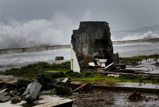 "<div class=""meta ""><span class=""caption-text "">A home that was built twice within the last two years is left in ruins during the passage of Tropical Storm Isaac near the seawall in Baracoa, Cuba, Saturday, Aug. 25, 2012. Tropical Storm Isaac pushed into Cuba on Saturday after sweeping across Haiti's southern peninsula. Isaac's center made landfall just before midday near the far-eastern tip of Cuba. (AP Photo/Ramon Espinosa) (AP Photo/ Ramon Espinosa)</span></div>"