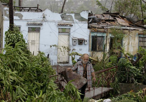 A man tries to recover his belongings from his house destroyed by Hurricane Sandy in Santiago de Cuba, Cuba, Thursday Oct. 25, 2012. Hurricane Sandy blasted across eastern Cuba on Thursday as a potent Category 2 storm and headed for the Bahamas after causing at least two deaths in the Caribbean. &#40;AP Photo&#47;Franklin Reyes&#41; <span class=meta>(AP Photo&#47; Franklin Reyes)</span>