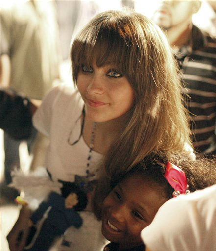 Paris Jackson, daughter of entertainer Michael Jackson, poses with a fan outside Jackson&#39;s boyhood home during a celebration on what would have been Jackson&#39;s  54th birthday, Wednesday, Aug. 29, 2012, in Gary, Ind. &#40;AP Photo&#47;Sitthixay Ditthavong&#41; <span class=meta>(AP Photo&#47; Sitthixay Ditthavong)</span>