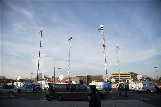 TV live trucks covering the shooting at Azana Spa in Brookfield, WI Sunday , Oct. 21, 2012. &#40;AP Photo&#47;Tom Lynn&#41; <span class=meta>(AP Photo&#47; Tom Lynn)</span>