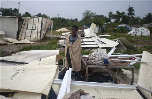 A man stands next to his bed after Tropical Storm Isaac destroyed his home and others at a camp set up for people displaced by the 2010 earthquake in Port-au-Prince, Haiti, Saturday, Aug. 25, 2012. Tropical Storm Isaac swept across Haiti&#39;s southern peninsula early Saturday, dousing a capital city prone to flooding and adding to the misery of a poor nation still trying to recover from the 2010 earthquake. &#40;AP Photo&#47;Dieu Nalio Chery&#41; <span class=meta>(AP Photo&#47; Dieu Nalio Chery)</span>