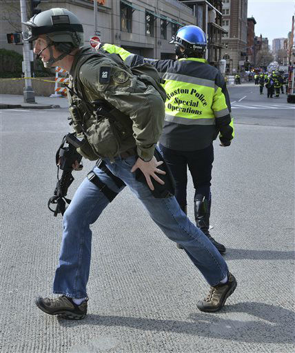 An armed FBI agent passes a Boston police officer following an explosion at the finish line of the 2013 Boston Marathon in Boston, Monday, April 15, 2013. Two explosions shattered the euphoria of the Boston Marathon finish line on Monday, sending authorities out on the course to carry off the injured while the stragglers were rerouted away from the smoking site of the blasts. &#40;AP Photo&#47;Josh Reynolds&#41; <span class=meta>(AP Photo&#47; Josh Reynolds)</span>