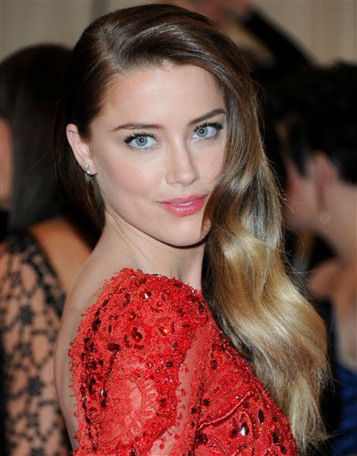 "Actress Amber Heard attends The Metropolitan Museum of Art Costume Institute gala benefit, ""Punk: Chaos to Couture"", on Monday, May 6, 2013 in New York. (Photo by Evan Agostini/Invision/AP)"