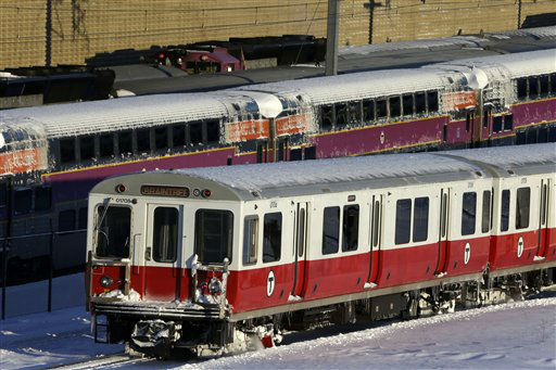 Massachusetts Bay Transportation Authority commuter trains wait to  start running again early Sunday, Feb. 10, 2013 in Boston. The MBTA hopes to have commuter train service fully restored for the Monday morning rush hour. &#40;AP Photo&#47;Gene J. Puskar&#41; <span class=meta>(AP Photo&#47; Gene J. Puskar)</span>
